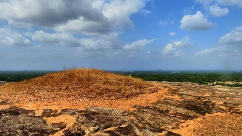 Remains of the ancient stupa at the top of Kadiragala Rajamaha Viharaya rock.