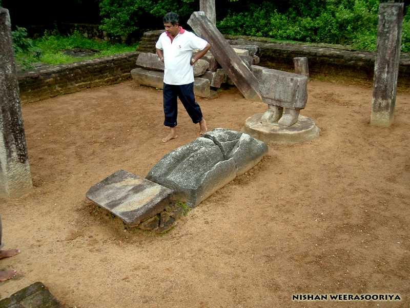 Fallen buddha statue at the image house - Dimbulagala Namal Pokuna Aramic Complex