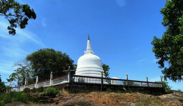The new stupa built on the ruins of the ancient stupa at the Veheragama Ruins - The forest of the Kubira Thero