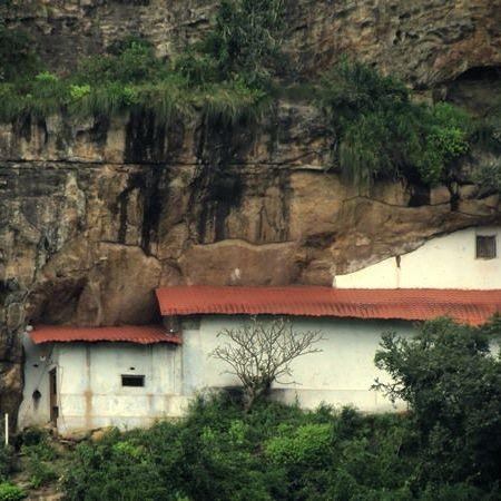 View of the caves of Sri Nagala Rajamaha Viharaya at Nikawewa from the road