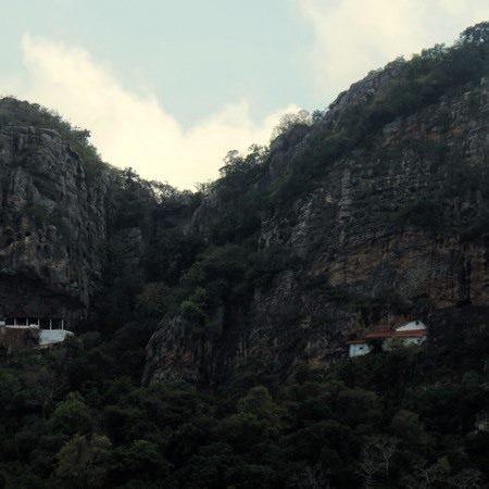 View of the 2 caves of Sri Nagala Rajamaha Viharaya at Nikawewa from the road