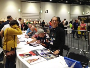 Chris Achilleos, at the Titan book signing, foreground, with artists Ian Miller, Jim Burns, John Harris seated behind him