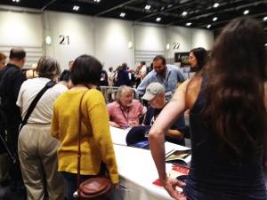 "Fred Gambino (cap) and Jim Burns signing books at the Titan Books launch for Jim's ""Hyperluminal"" art book"