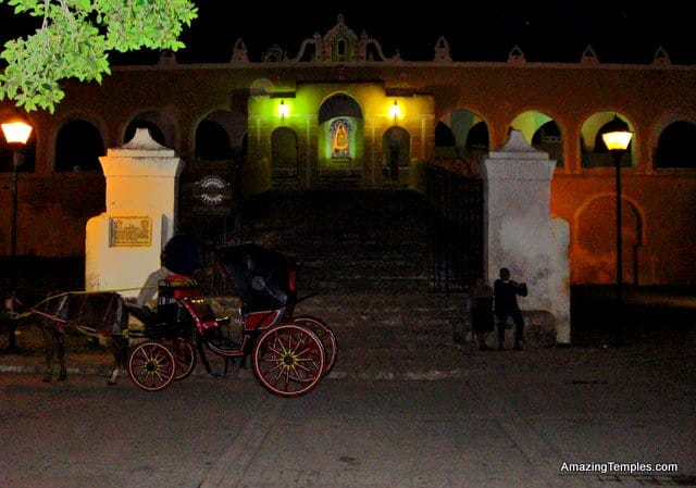 Izamal - in the night - looking to the gates of the monastery - a horse coach in front