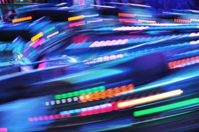 Funfair ride moving fast fair lights blurred