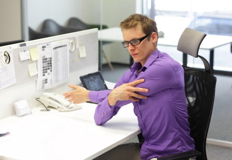 man office worker,exercising during work with tablet in his offi