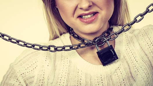 Sore throat, tonsillitis, health problems, lack of freedom concept. Woman having metal chain around neck