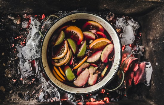 Mulled Wine Preparation. Red Wine With Spices, Apple, Oranges, C