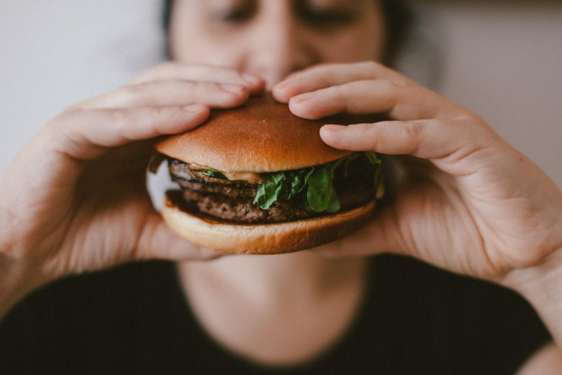 Man eats hamburger