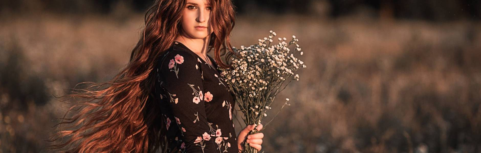 young woman in autumn flower field