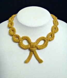 shelby allaho bow necklace