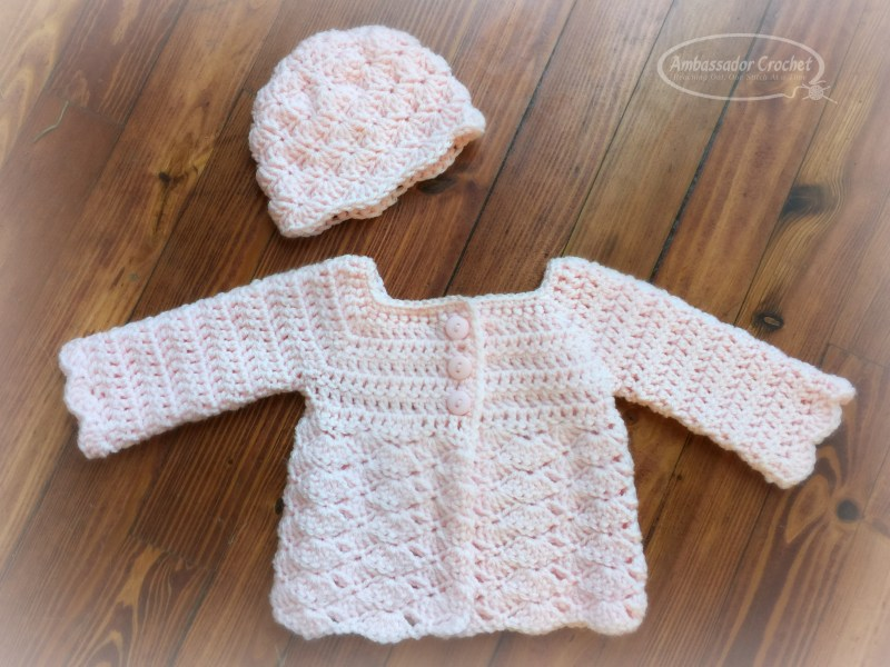 Sweet Shells Baby Sweater Crochet Pattern - This 0-3 month baby sweater is a free crochet pattern by Ambassador Crochet.