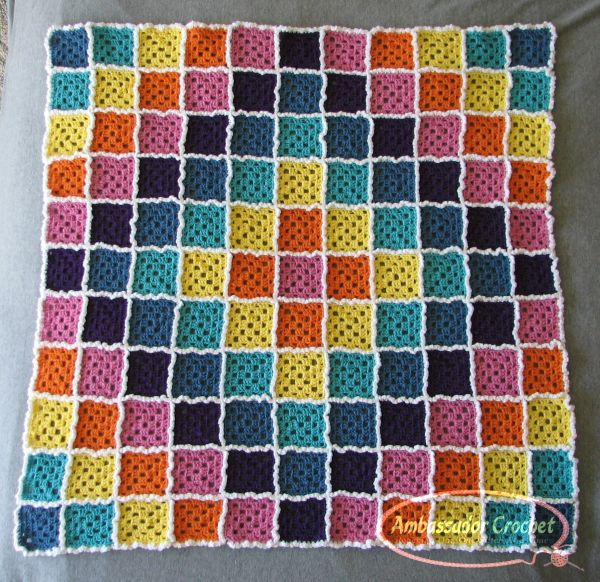Candy Cloud Burst rainbow baby afghan by Ambassador Crochet.