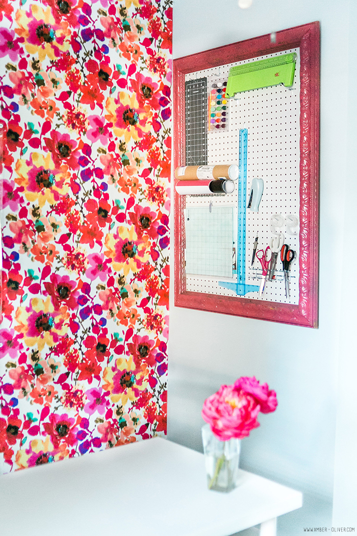 Office Makeover - Amber Oliver. Bright and cheerful office space with floral fabric covered wall. Photo by thinkelysian.com