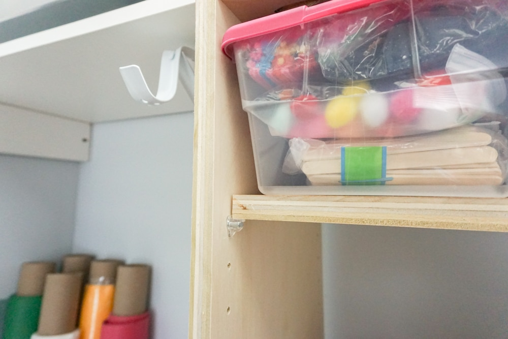 Close up of DIY closet shelves - perfect craft closet organization idea!