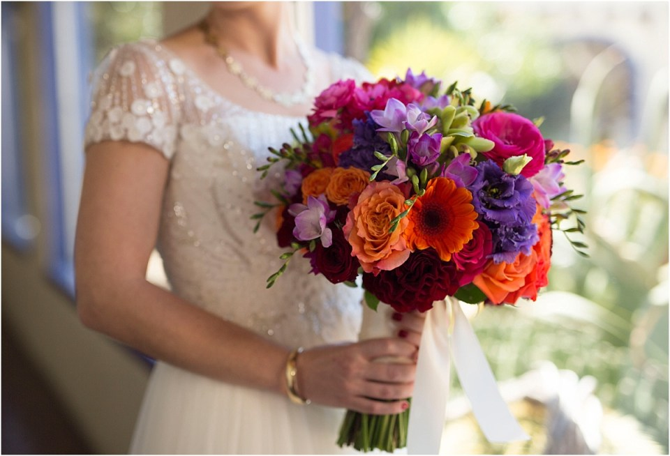 Bride's spring bouquet with red, purple and oranges made by Posh Petals.