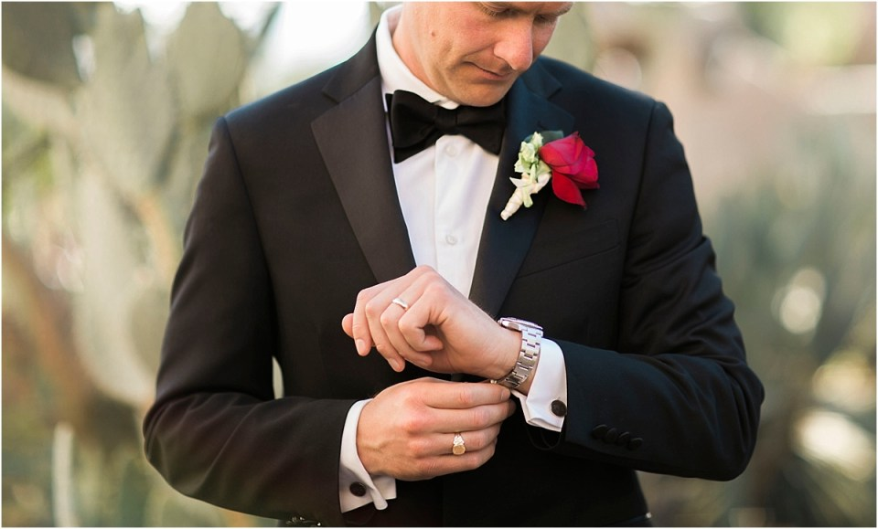 Grooms portrait checking his watch