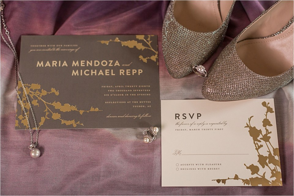 Gold and grey invitation suite.