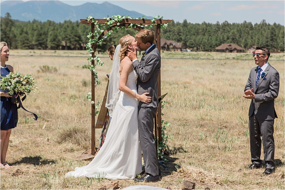 First Kiss under the arch in front of the San Francisco Peaks.