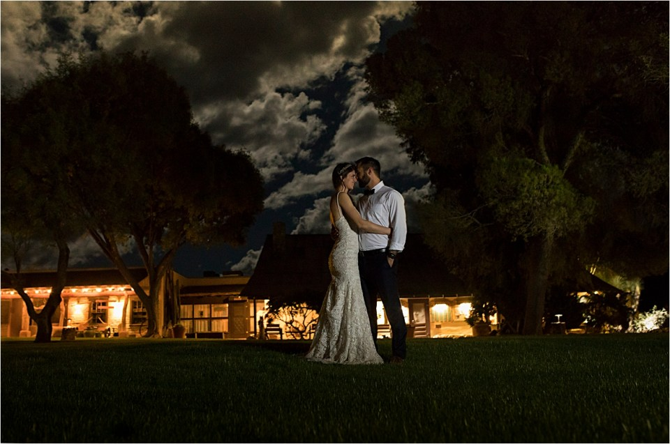 Bride and groom nighttime portrait at Tanque Verde Ranch.