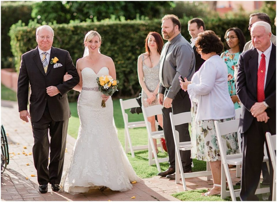 Bride with her father walking down the aisle of the Historic Arizona Inn, Tucson, Arizona