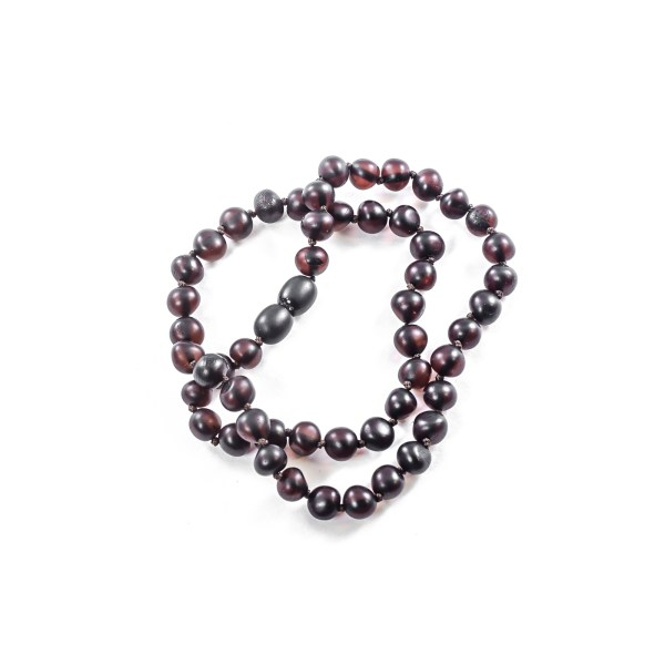 Cherry Beads Necklace on table
