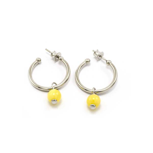 Round silver earrings with a drop of yellow amber
