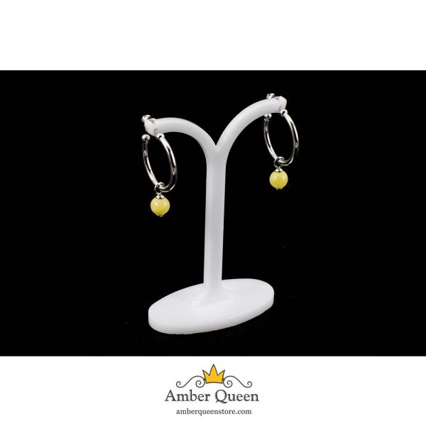 Round silver earrings with a drop of yellow amber on string