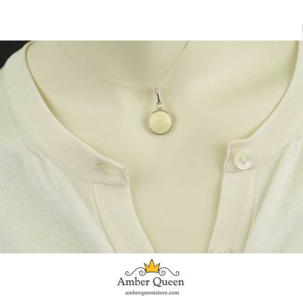 Round White Amber Pendant in Silver on Mannequin close