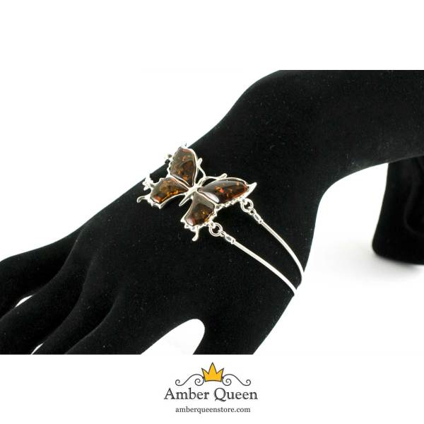 Thin Silver Butterfly Bracelet with Sparkling Cognac Amber on Hand