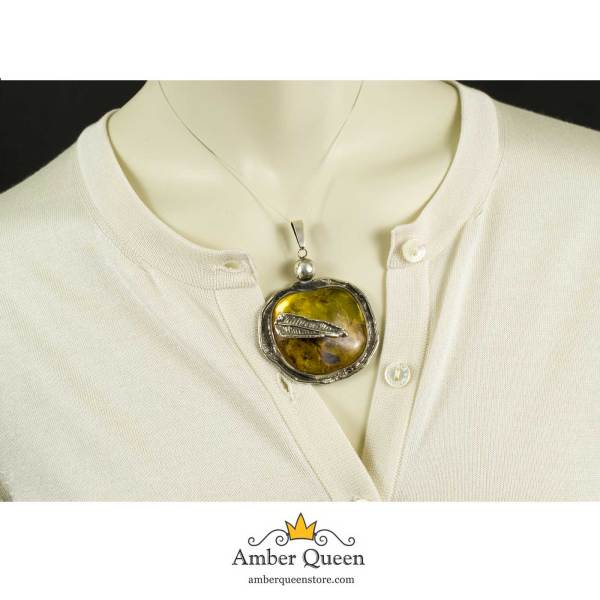 Vintage Massive Amber Pendant Medallion with Insect Wings Inclusions on Mannequin Close