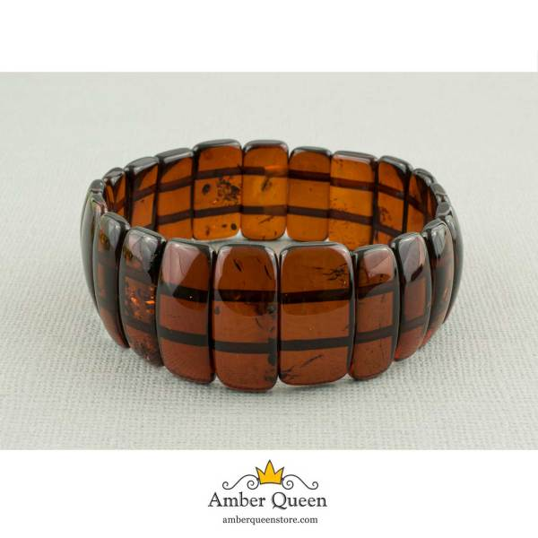 Cherry Flat Elastic Amber Bracelet On Grey Background