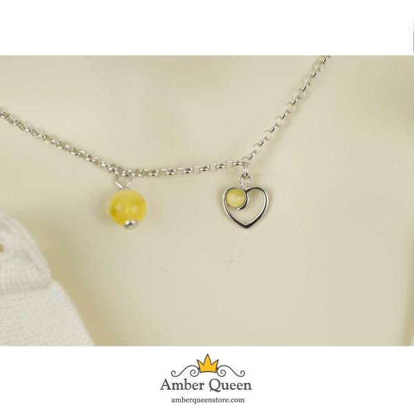 Siver Chain Necklace with Heart Pendant and Round Amber Stone on Mannequin Closeup