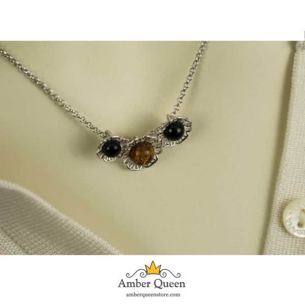 Silver Chain Necklace with Pearl Pendant and Three Amber Stones on Mannequin Closeup