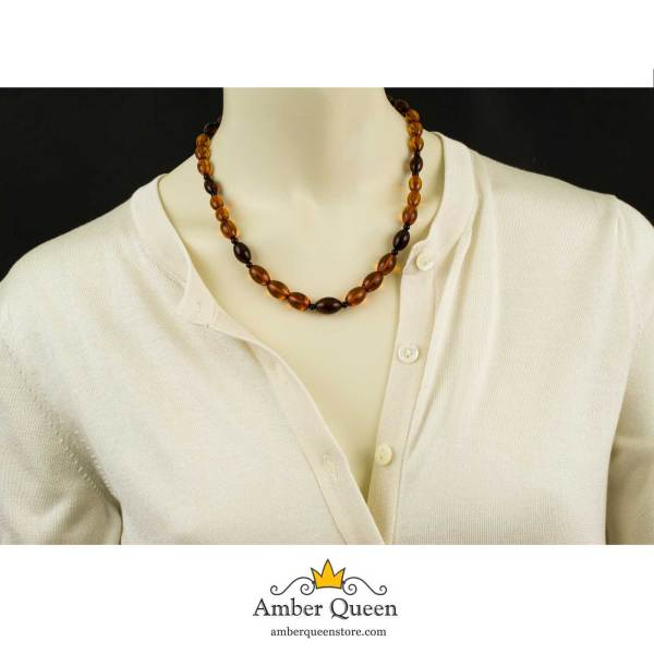 Cognac and Cherry Olive Amber Beads on Mannequin