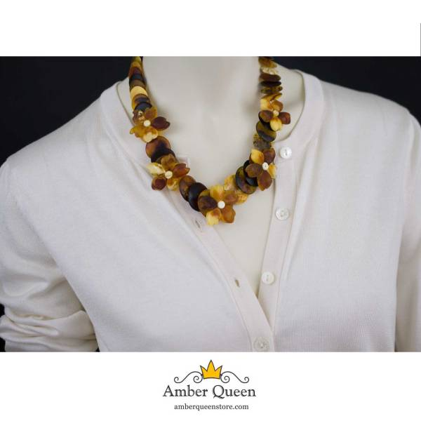 Unpolished Amber Necklace with Flowers on Mannequin