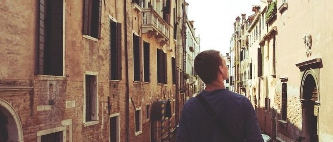 Image of male tourist looking at a building
