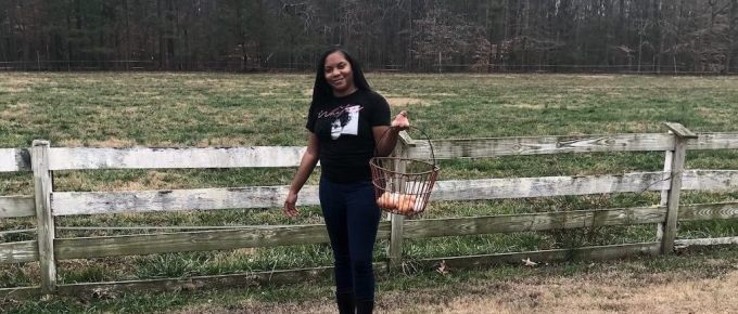 Leandra Thomas in front of her farm