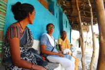 Shubhada explains the symbolism of our photo project to two women who are about to participate.