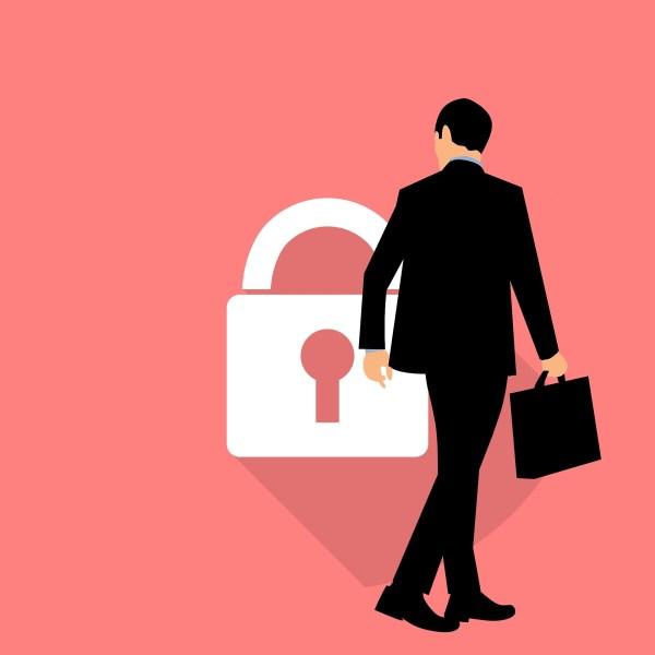 man looking at security lock