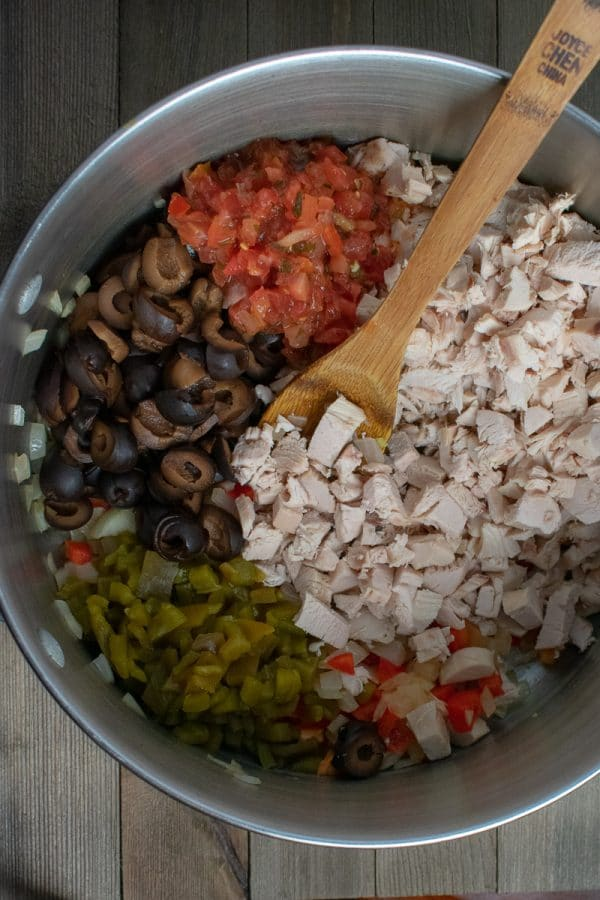 chicken and vegetables for enchiladas in stainless steel bowl