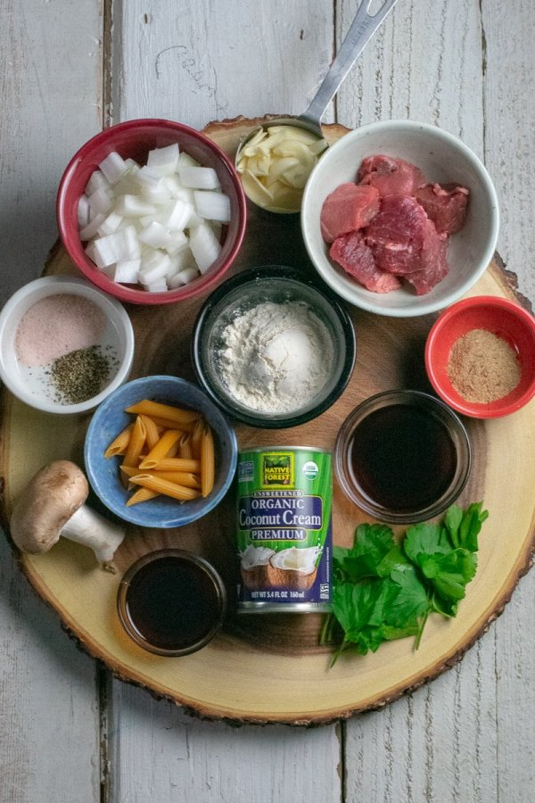 40 minute Instant Pot Beef Stroganoff ingredients on wood board