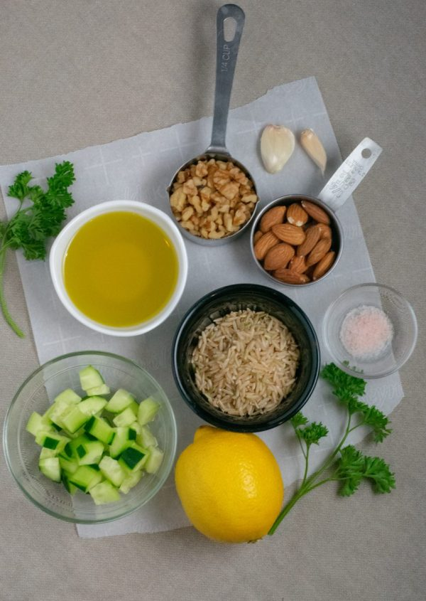 Ingredients for Nut Pesto Green Rice in small vessels on parchment