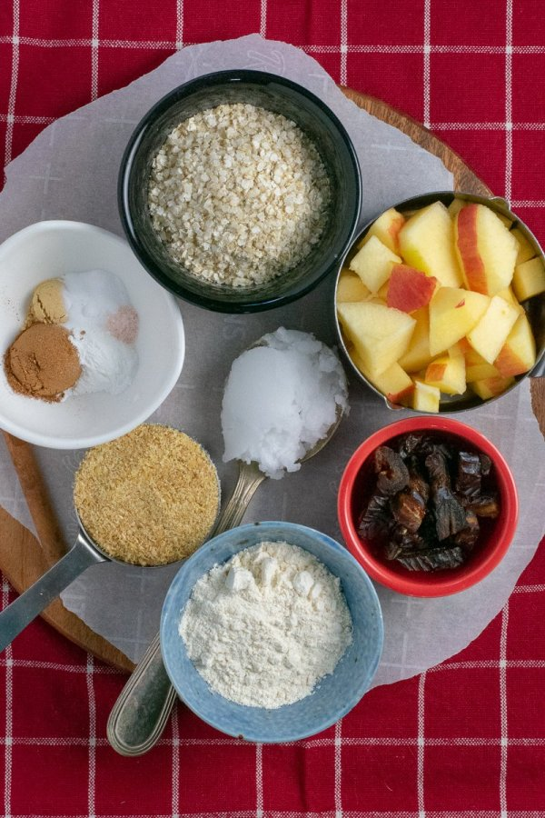 Ingredients for apple apricot muffins on wooden board