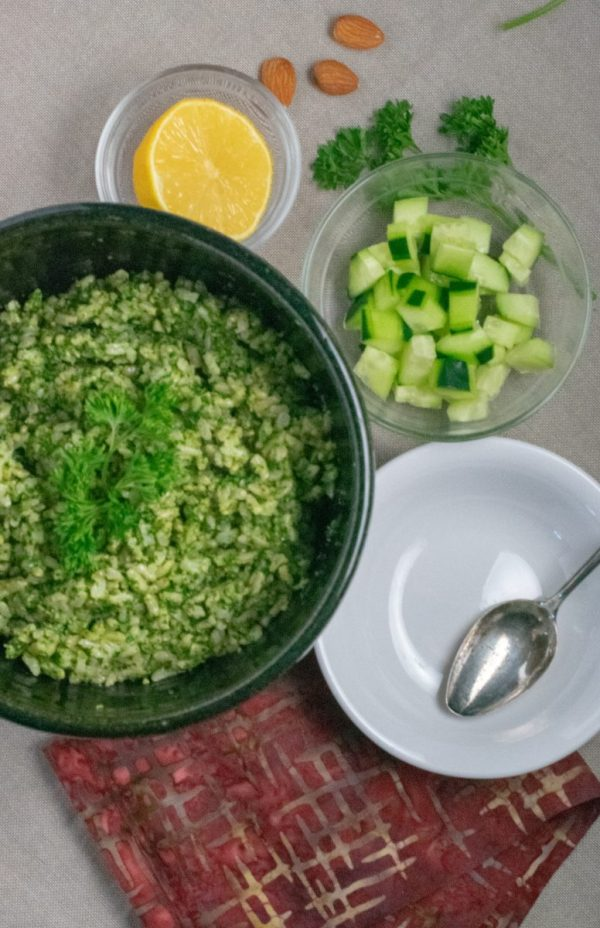 Nut Pesto Green Rice in large bowl with toppings in small bowls