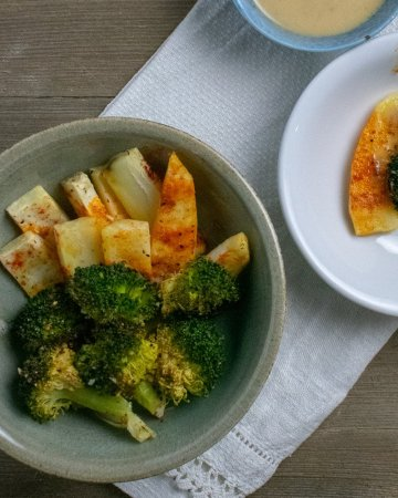 Roasted Broccoli and White Sweet Potatoes close up in green bowl