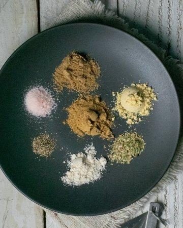 Taco seasoning gluten-free ingredients on black plate