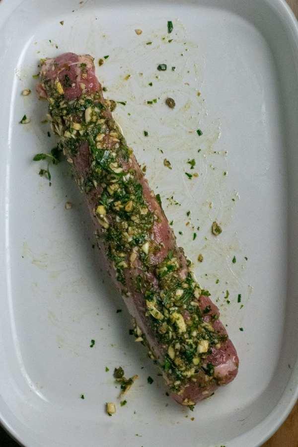Pork tenderloin with garlic-herb paste in baking pan
