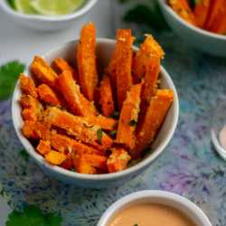 roasted sweet potato fries in small bowl with mayo and limes sq
