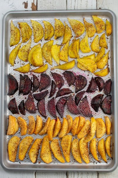 roasted beets and rutabagas in wedges on sheet pan